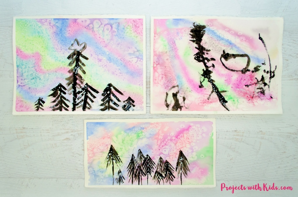 Create a beautiful northern lights watercolor painting using easy watercolor techniques that kids will love experimenting and having fun with!