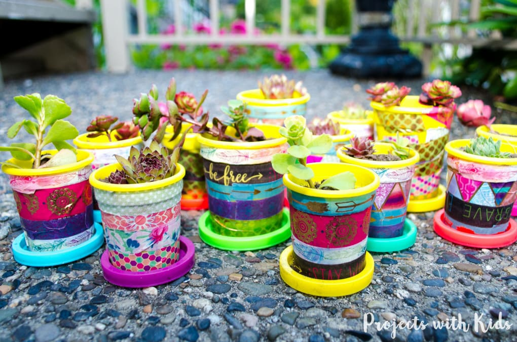 These mini plant pots are too cute for words! Colorful washi tape is all it takes to transform these recycled containters into little works of art. Perfect for giving as gifts!