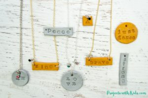 Learn how to make these stamped polymer clay necklaces that kids will have tons of fun making! These necklaces are sparkly and gorgeous and perfect for customizing, kids will love giving these as gifts and of course keeping some for themselves! Use initials, important dates, favorite hobbies, the possibilities are endless!