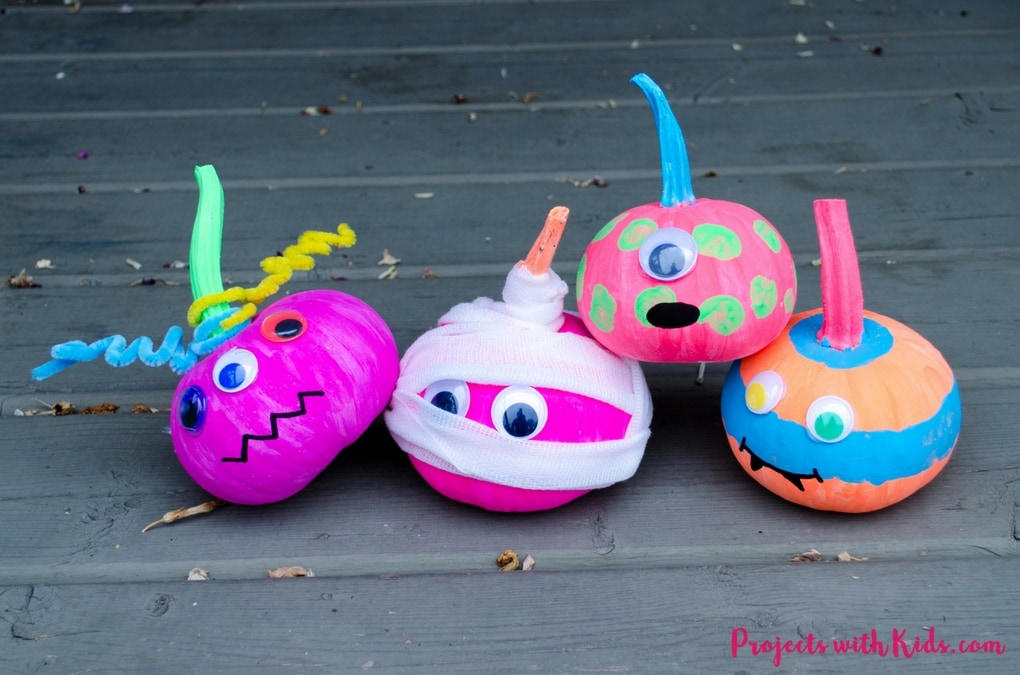 Cute not scary, these easy neon colored no-carve pumpkin monsters are so fun for kids to create! They would make an adorable addition to any front porch this Halloween. Click on the full post to see all the spooky details!