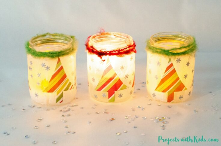 Start saving your jars, these magical Christmas lanterns are so fun and easy to make, you and your kids will want to make more than one!  They look absolutely stunning lit up with a candle inside and would make the perfect addition to any holiday decor.
