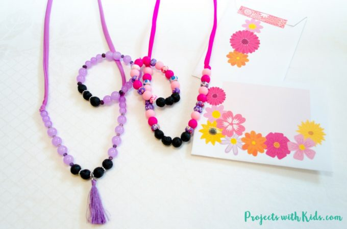 These lava bead diffuser jewelry sets make the perfect handmade gift for any occasion! So easy to make and customize with someone's favorite color and essential oils, kids will love helping to make these for someone special. Plus you can gift wrap them in the most adorable free printable gift pouches! I've included 4 designs to choose from. #projectswithkids #diffuserjewelry #HandmadeHolidays