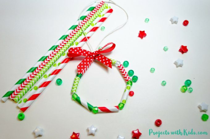 So bright and cheerful these kid made wreath ornaments are the perfect colorful addition to any Christmas tree. Easy and fun for kids of all ages to make!