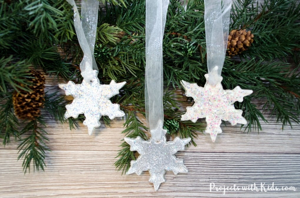 Add some sparkle and shine to your Christmas tree with these glitter snowflake ornaments. An easy DIY Christmas ornament for kids of all ages to make.