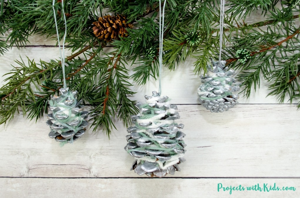 These pinecone ornaments are so simple and beautiful! They make a great fine motor activity and an easy Christmas craft kids of all ages will enjoy creating.