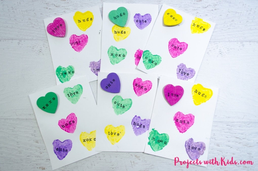These conversation hearts cards and pins are so fun for kids to make! The perfect Valentine's Day craft and art project, kids will love making cards and cute jewelry for their friends.