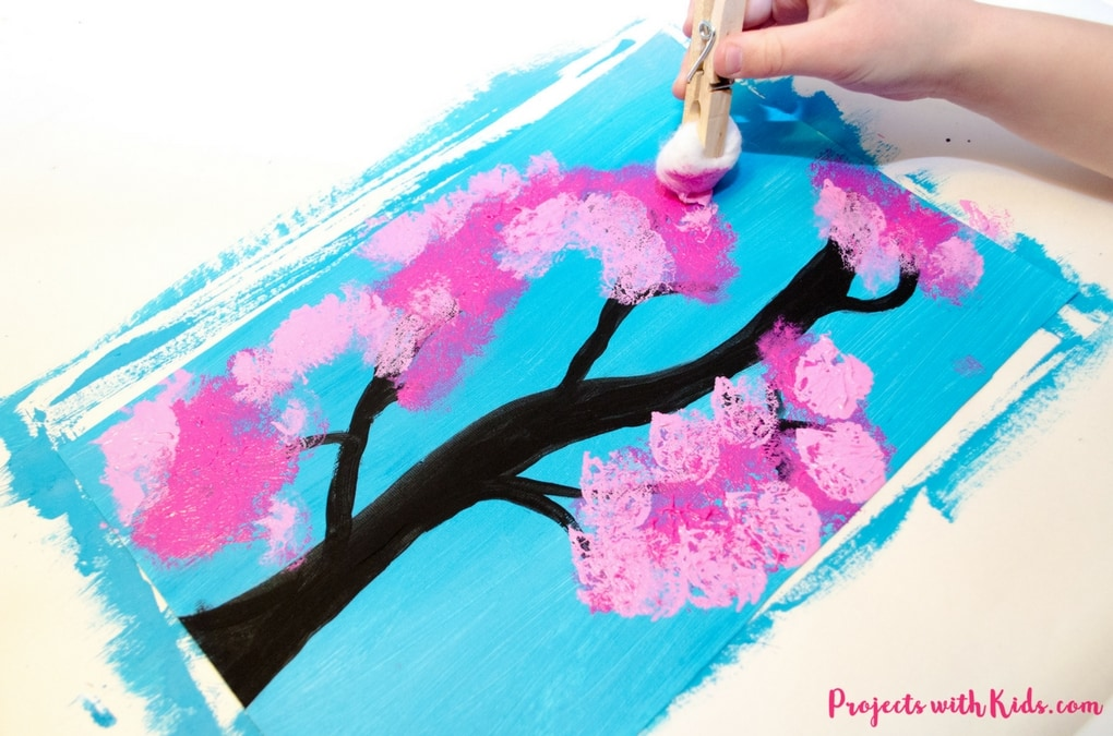 Kids will love painting with cotton balls to create this cherry blossom art for kids.