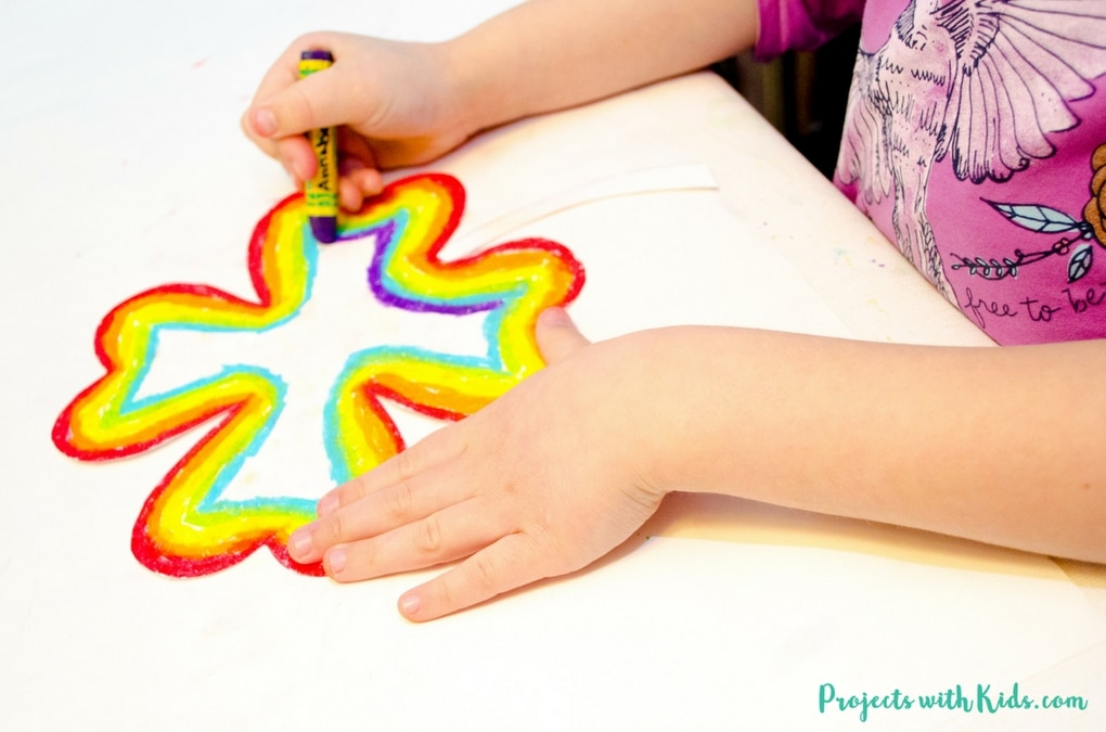 Brighten up your day with this easy rainbow shamrock craft using oil pastels. So fun and colorful, kids will love using vibrant oil pastels to create a rainbow in the shape of a shamrock. A great St. Patricks day craft project. Free printable template included!
