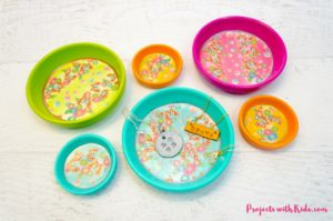 These kid made jewelry dishes make the perfect Mother's Day craft. Bright and colorful and super easy to make, kids will love making their mom's this special gift. This craft is easily customizable with different colors and patterns.