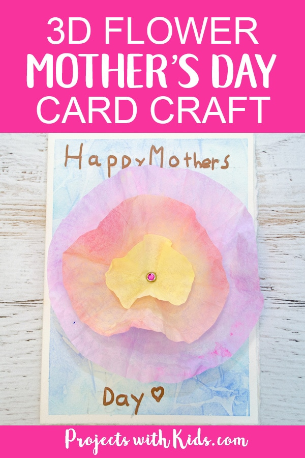 This 3D flower Mother's Day card craft is such a beautiful project for kids to make for their moms or grandmas for Mother's Day! Coffee filters and watercolor paint make a gorgeous 3D flower while the background is made with a unique and easy watercolor technique that kids will have fun creating. Kids will love making this gorgeous card for someone special. #mothersday #watercolorpainting #projectswithkids #mothersdaycraft #flowercrafts