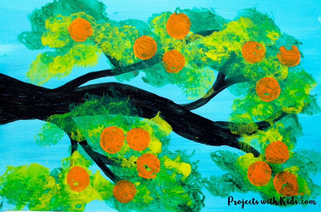 Kids will love using cotton balls to paint this orange tree with gorgeous shades of green and then stamp on oranges using another fun painting tool! Using cotton balls to create the leaves of this fruit tree creates a fluffy texture that is perfect for this summer tree project. Free printable template included!