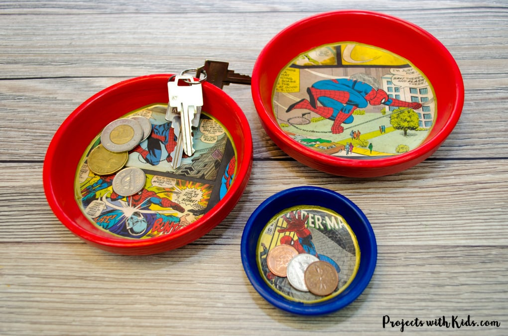 Give dad or grandpa a super place to put spare change, keys or desk clutter with this superhero trinket dish Father's Day craft and gift. Perfect for at the front door, on a dresser or at a desk. This superhero trinket dish is an awesome handmade gift that is sure to be a big hit! Kids will love making this craft for someone special.