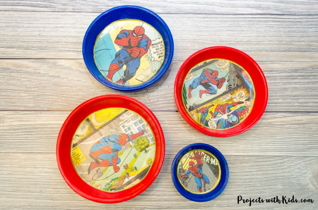 Give dad or grandpa a super place to put spare change, keys or desk clutter with these superhero trinket dishes Father's Day craft and gift. Perfect for at the front door, on a dresser or at a desk. This superhero trinket dish is an awesome handmade gift that is sure to be a big hit! Kids will love making this craft for someone special.
