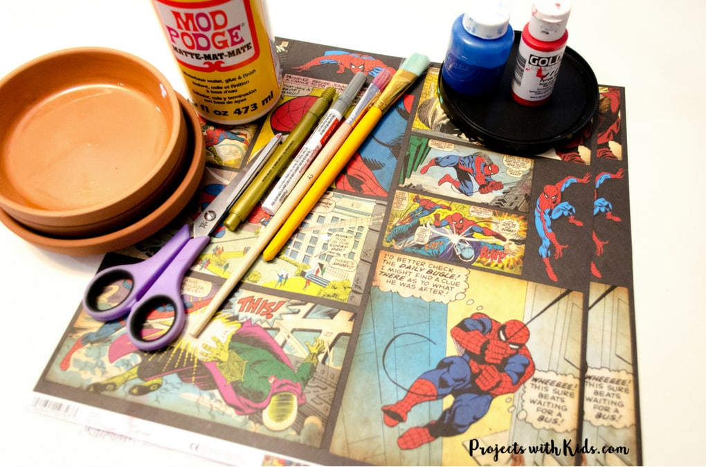 Give dad or grandpa a super place to put spare change, keys or desk clutter with this superhero trinket dish Father's Day craft and gift. Perfect for at the front door, on a dresser or at a desk. This superhero trinket dish is an awesome handmade gift that is sure to be a big hit! Kids will love making this craft for dad or grandpa.