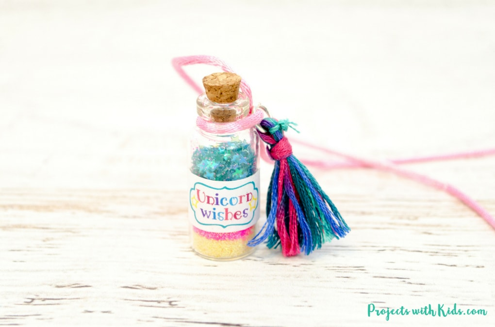 This unicorn necklace kids craft is magical! Kids will love creating their own jars of unicorn wishes and customizing their necklaces. The perfect craft for birthday parties, playdates and summer camp. Free printable labels are included, making these necklaces even more adorable!