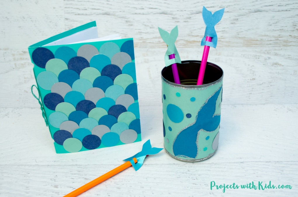 Kids will love making these adorable mermaid diy school supplies! Make a mermaid scales notebook, a mermaid pencil holder and adorable mermaid tail pencil toppers. A fun back to school craft. Free printable templates included.