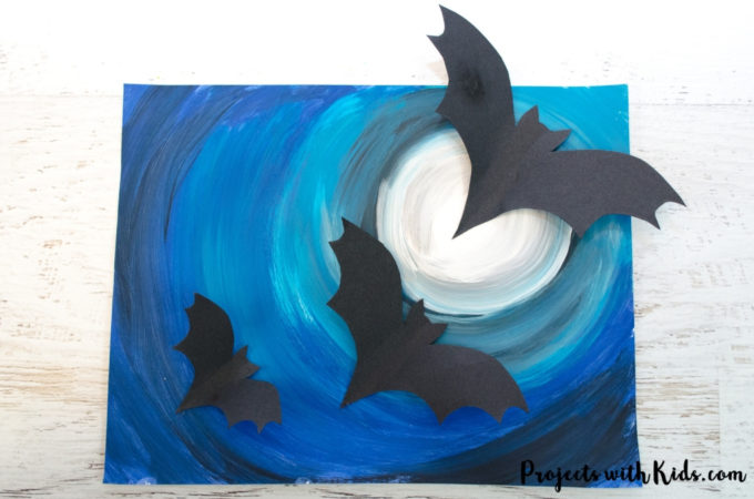 A full moon, spooky Halloween sky and flying bats come together to make this awesomely spooky Halloween art project that kids will love to create! Free bat templates included.