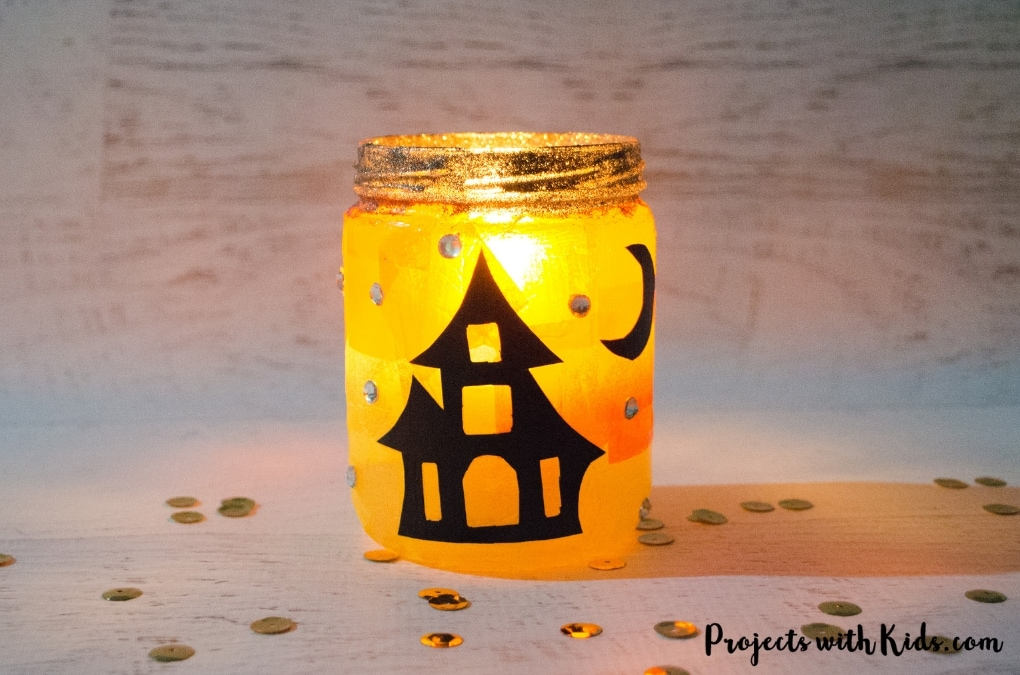 Kids will love to create these gorgeous Halloween lanterns that sparkle and glow in the candlelight! A fun Halloween craft to help decorate for the season. Free printable templates included.