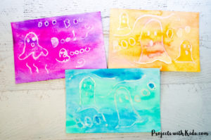 Kids will love watching their ghost pictures appear with this easy watercolor resist technique. A fun non-scary Halloween craft for kids.