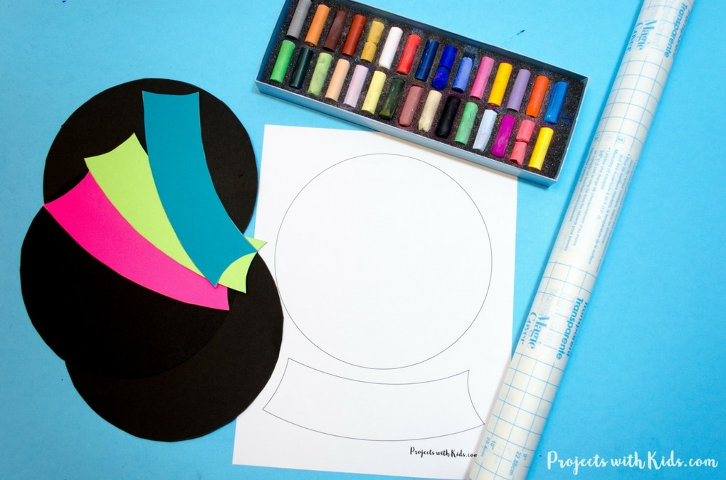 Brighten up your winter with this colorful snowglobe craft. Chalk pastels on black paper help make these snow globes extra vivid. Kids will love creating their own winter wonderland scene and exploring chalk pastels! Free printable template included.
