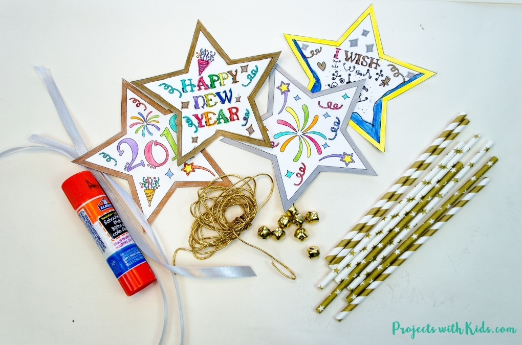 Ring in the New Year with this festive wand craft. An easy New Year's Eve craft that kids can also use as a noisemaker. 5 free printable designs to mix and match for kids to have fun with!