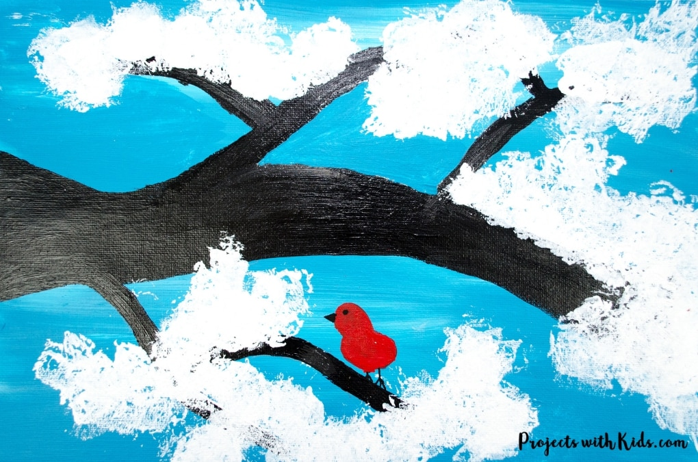 Kids will love creating this cute & easy winter tree painting using cotton balls. Add in a fingerprint red bird for an extra fun winter touch. Free printable branch template included.