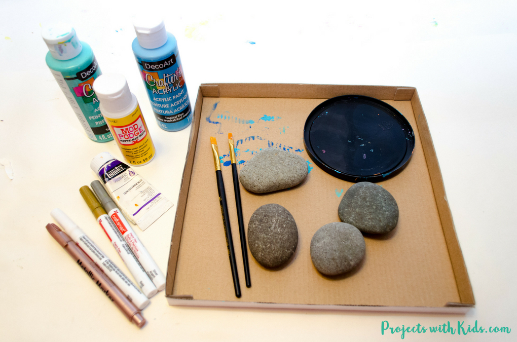 Easy steps for how to draw mermaid scales on painted rocks. A fun rock painting activity for kids that would be perfect for playdates, birthday parties, summer camps or any time!
