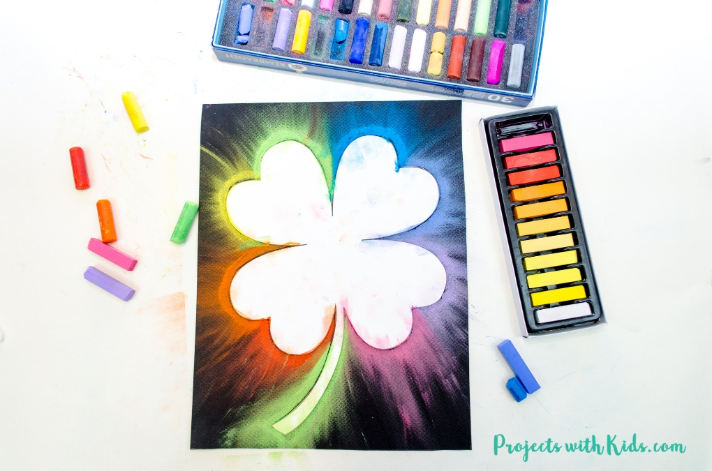 This shamrock art is beautiful and so fun for kids to make! Kids will love using this easy chalk pastel technique to create a brightly colored St. Patrick's Day craft. Free shamrock template included.