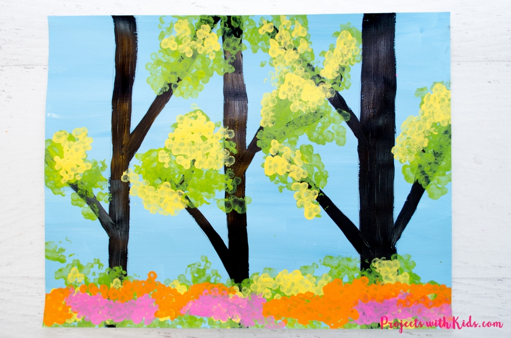 This gorgeous spring trees painting is so fun to make! Using bundled q-tips makes this an easy art project for kids of all ages. Free printable trees template included.