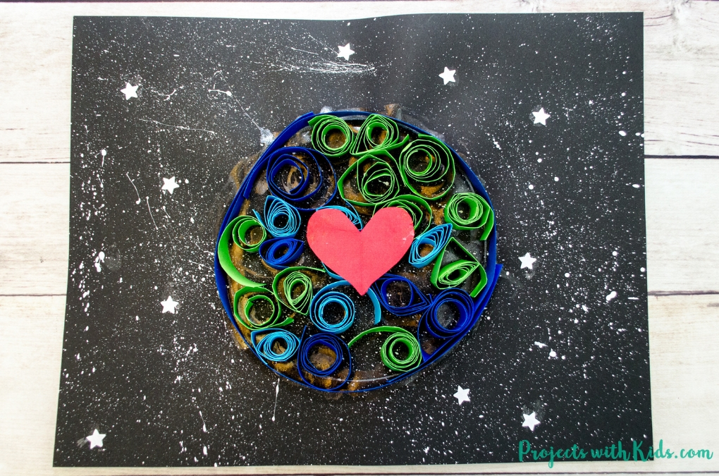 Kids will love to create this gorgeous earth day craft using simple quilling techniques with no special tools required. Using black paper and a starry sky really makes this art project stand out.