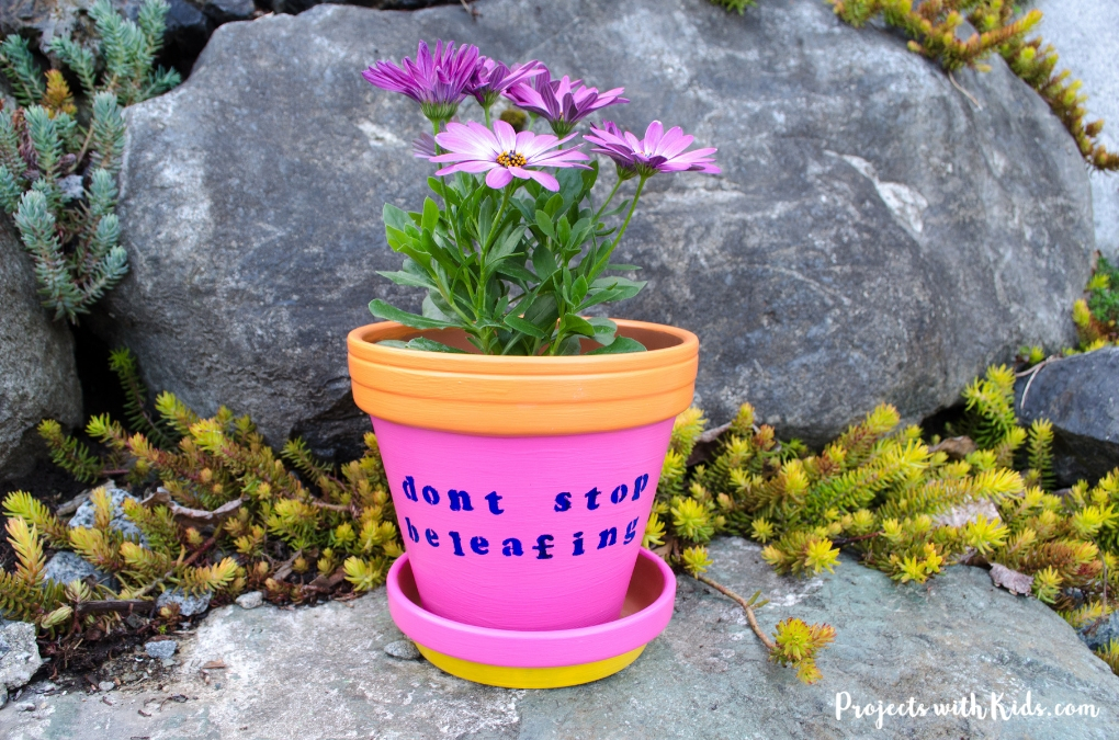 These bright and cheerful DIY painted flower pots are so fun and easy for kids to make! A wonderful kid-made gift idea for Mother's Day, and a great summer craft project.
