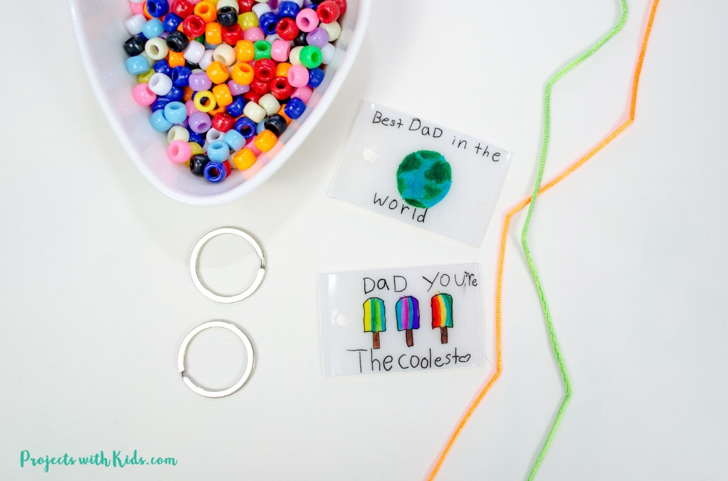 baked shrinky dink keychains with beads and string
