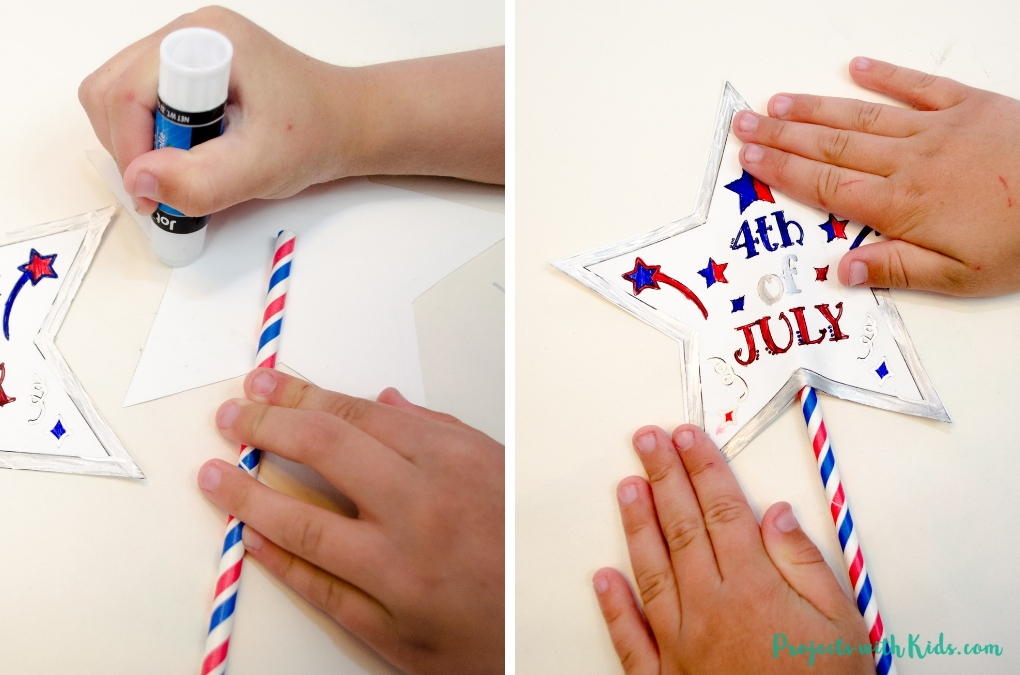 Gluing together 4th of July printable wands & noisemakers.