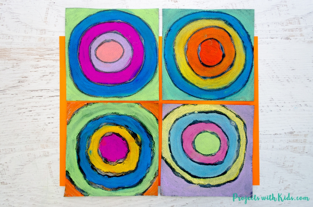 Kandinsky inspired circle art made with chalk pastels and glue.