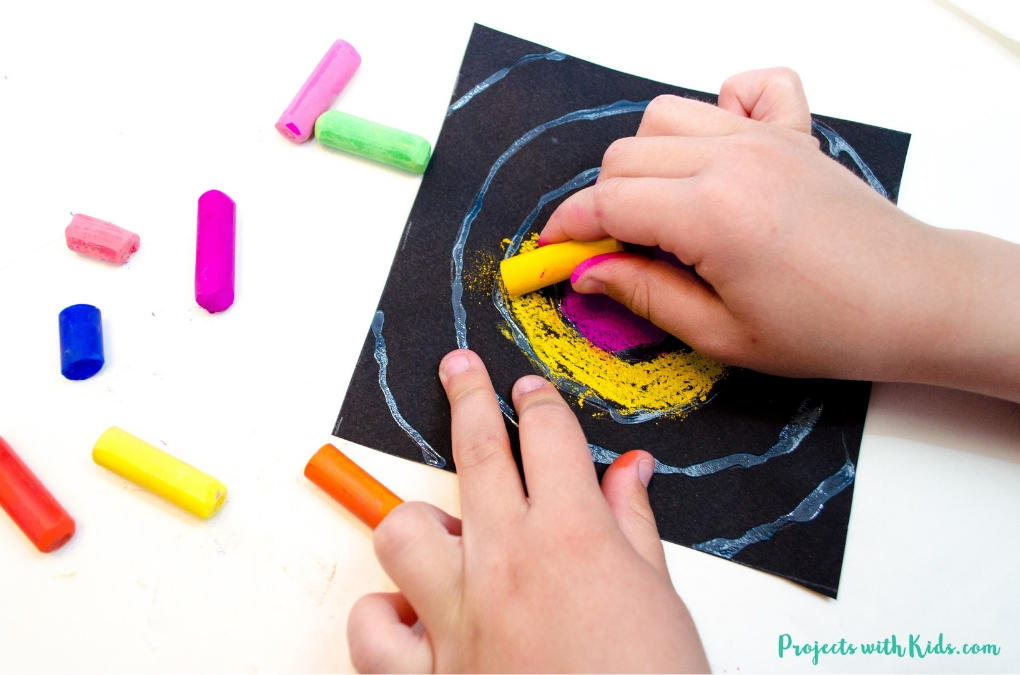 Drawing with chalk pastels.