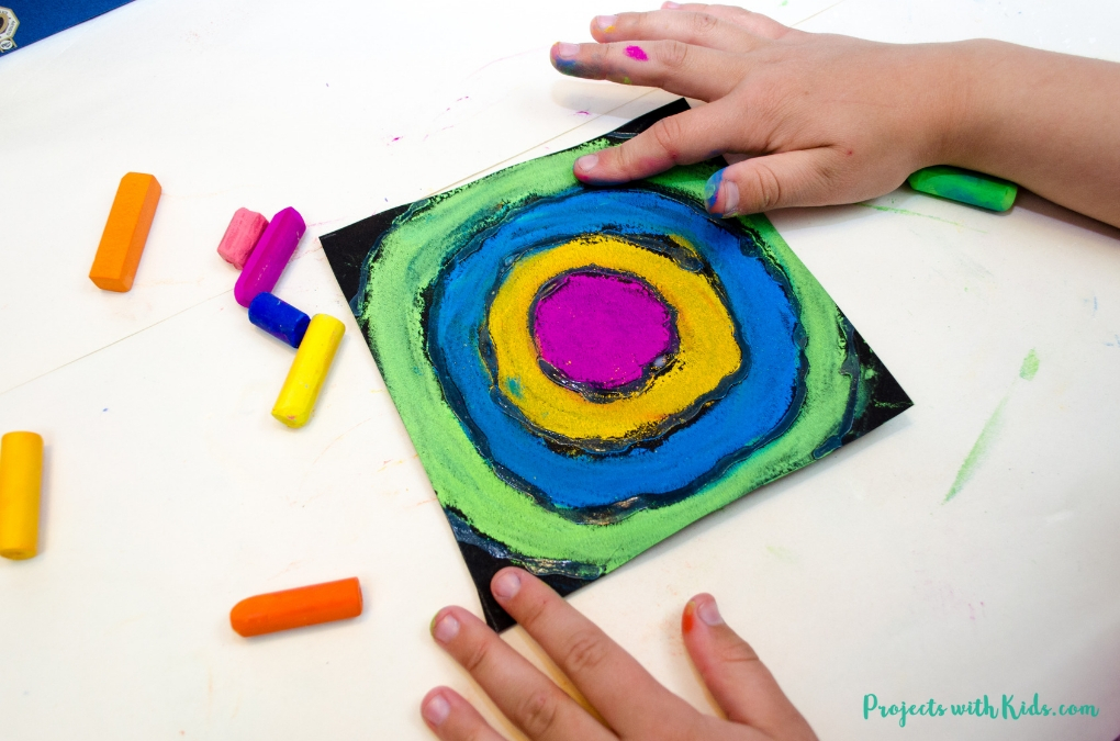 Finishing a Kandinsky for kids art project.