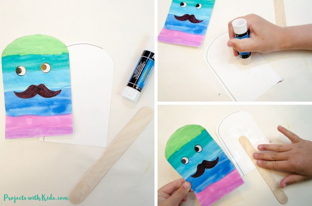 Finishing the Father's Day card craft with glue and a popsicle stick.