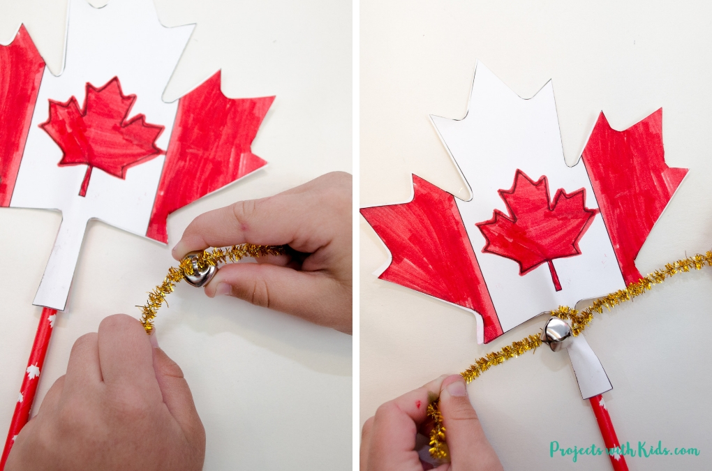 Adding pipe cleaners and bells to Canada Day craft.