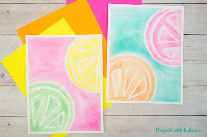 2 citrus watercolor paintings with oil pastel resist.
