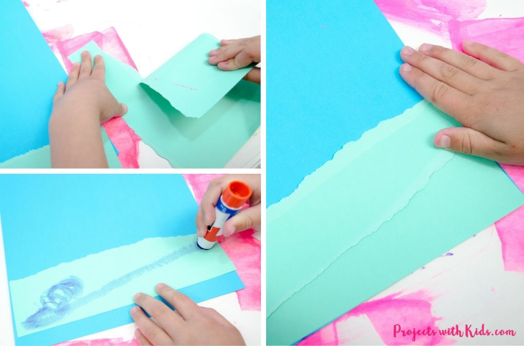 Tearing pieces of blue paper and glueing them down onto sky blue paper to make water.