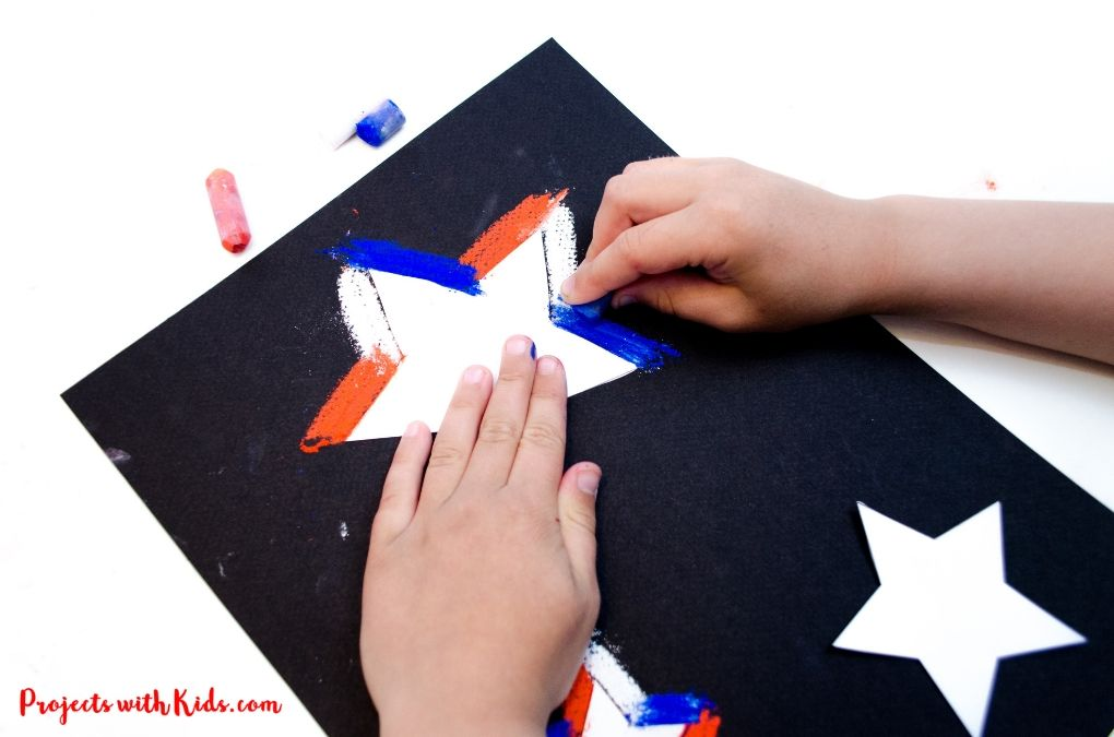 Drawing around a star template with chalk pasetls