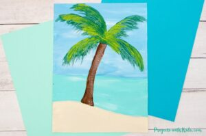 Palm tree painting on sand with water.