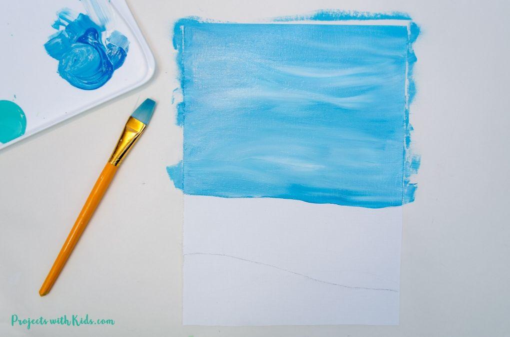 Blue sky painted onto a canvas.
