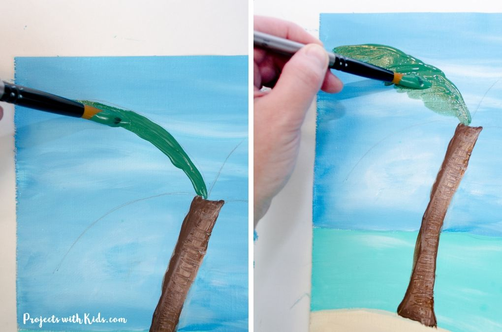 Painting in the leaves of a palm tree with dark green.