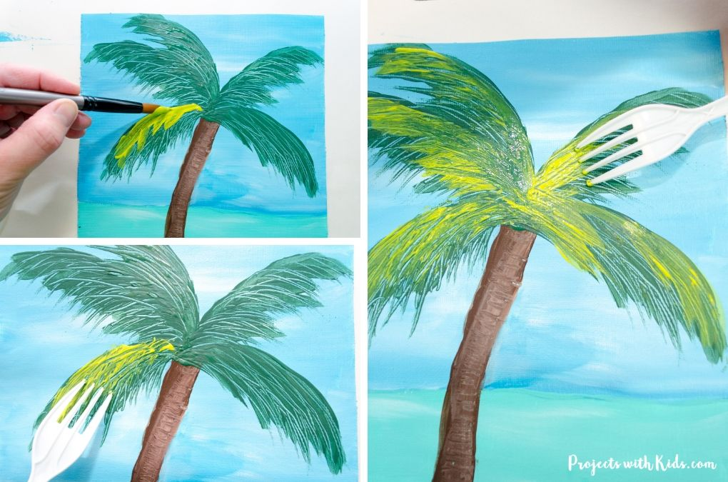 Painting in a light green to the palm tree leaves with a paintbrush first, then using a fork to create texture.