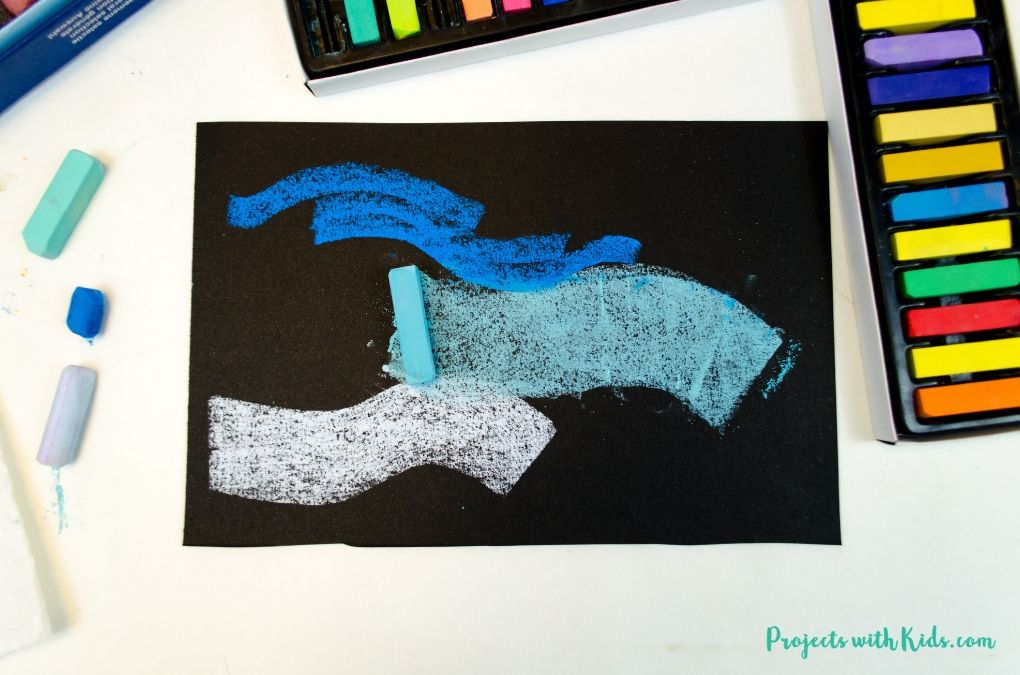 Thick blue chalk pastel lines using the flat edge of a pastel.
