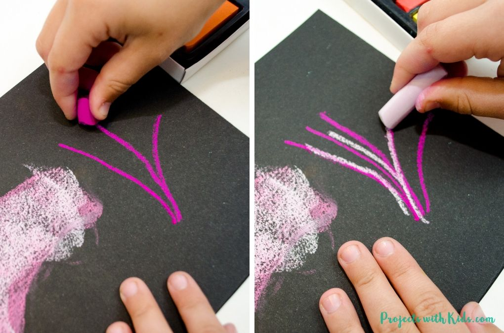 Drawing lines and layering with pink chalk pastels.