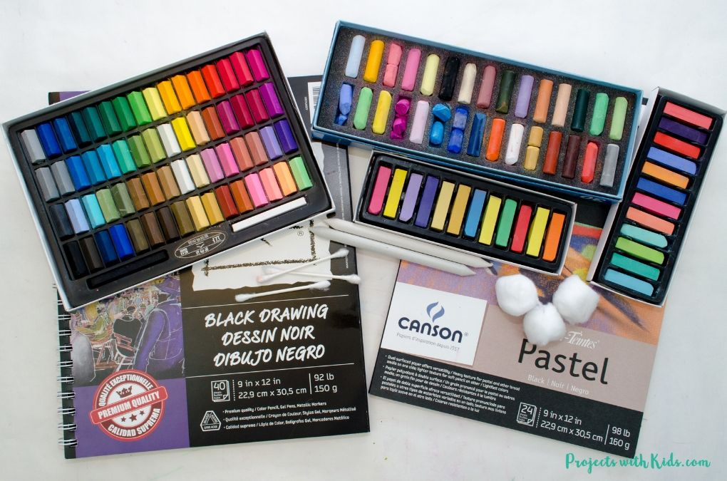 Supplies needed to make pastel art-chalk pastels, black paper, q-tips, blending sticks and cotton balls.