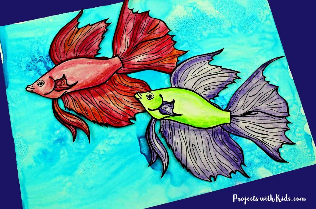 2 watercolor fish on a blue watercolor background.