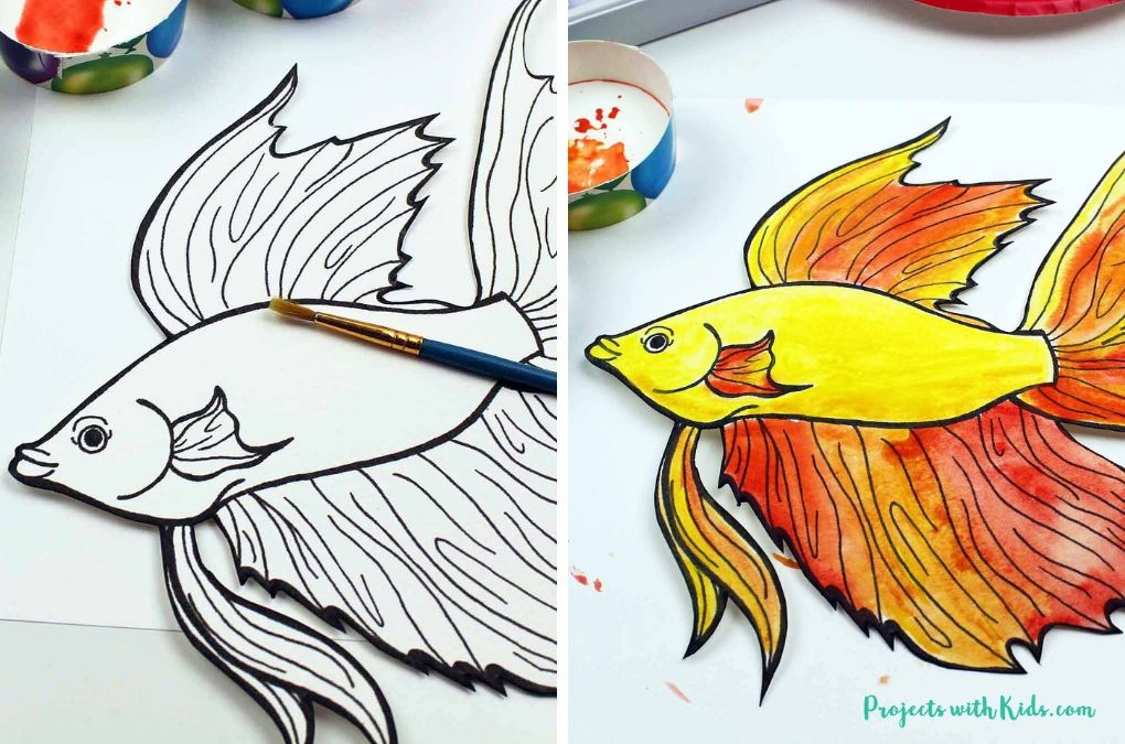 Painting a printed fish template with orange and yellow watercolor paint.